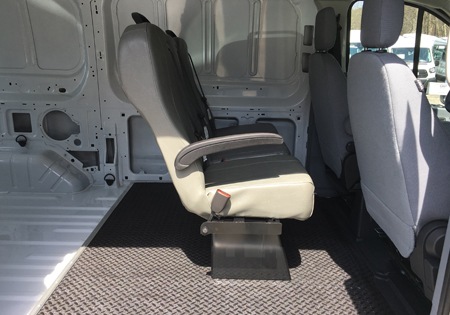 interior of white van with one row of seats