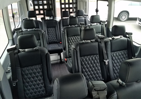 interior of ADA accessible vehicle with black seats