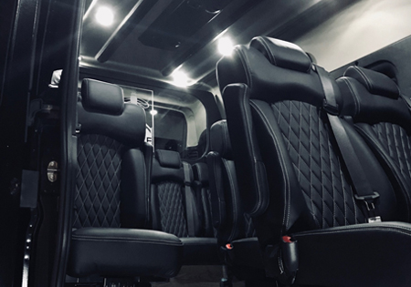interior of black van with leather seats