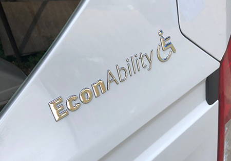 close-up of van with words econability