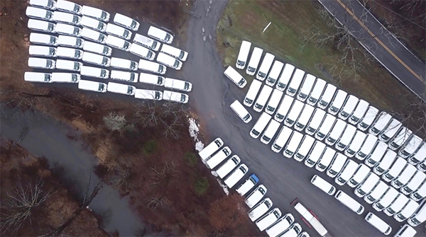 aerial image of parked white vans